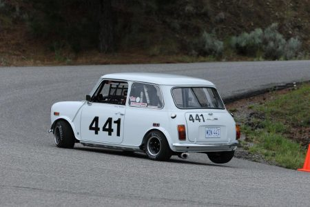 VRCBC member Geoff Tupholme lifts a rear wheel en route to a new personal best and Vintage Class win in his very fast Austin Mini. - Brent Martin photo