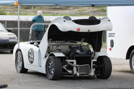 Karlo Flores' classic Bugeye Austin Healey Sprite has a big yawn while waiting for its next turn on the track. - Brent Martin photo