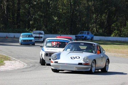 David Hogg (Porsche 911) holds off Ian Thomas (BMW 2002) and an almost hidden Mike Hawthorne (Porsche 944) through Mission's Turn 5 with Leigh Anderson (BMW 1600), Ian Wood (Volvo 142S) and Paul Haym (Datsun 510) in hot pursuit. - Brent Martin photo