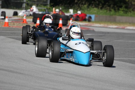 Tedd takes over the lead! New for 2014 VRCBC President Tedd McHenry (XPit F4) shows former president Stanton Guy (Caldwell FVee) how it's done. - Brent Martin photo