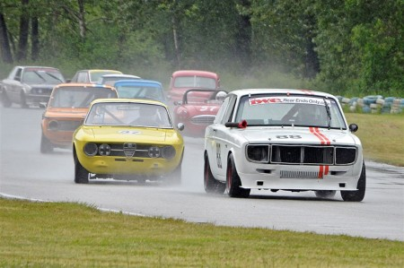 'Splish Splash!' Ian Wood leads Glen Gibbons, Ron Dempsey and the rest into Turn 2. - Jim Moody photo
