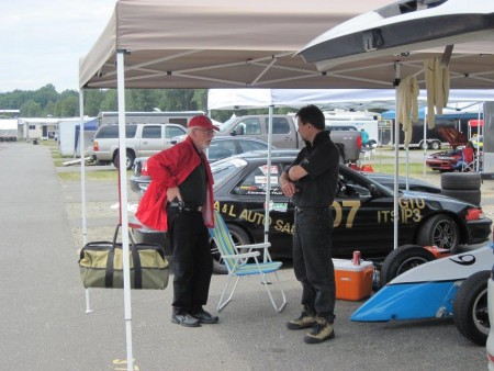 "'A word from the wise."" Former VRCBC president Jim Latham (L) reminds current president Tedd McHenry to always check the schedule before heading to the track. - VRCBC photo"