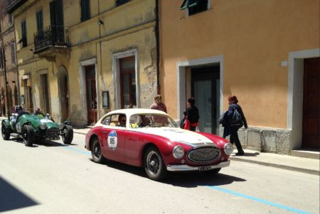 Two classics motor down a classic Italian village street during the 2016 Mille Miglia. - Ann Peters photo