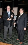 Al 'Hoser' Reid receives his Brass Nozzle Award from Dennis Repel - C. Wood photo