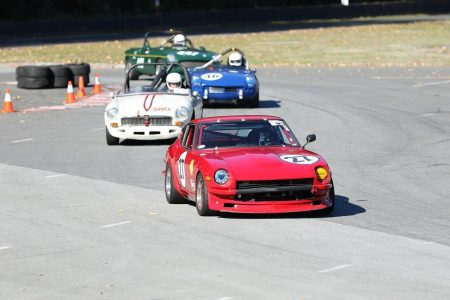 A typical Vintage racing battle: twelve (3 X 4) British cylinders chase six (younger) Japanese ones. Phil Linzey (1971 Datsun 240Z) leads Stanton Guy (1966 MGB), Phil Pidcock (1965 Triumph Spitfire) and John Elliott (1969 MGB). - Brent Martin photo