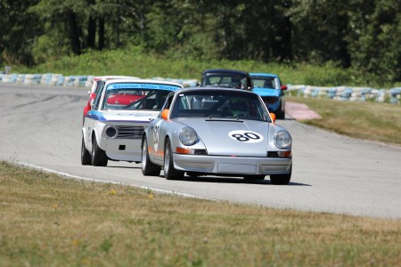 Vintage racing newcomer, David Hogg (Porsche 911) leads veteran Ian Thomas (BMW 2002) and Jorge Montesi (Austin Cooper S), Peter Valkenburg (Volvo PV544) and 2012 REVS Champion Paul Haym (Datsun 510) - Brent Martin photo