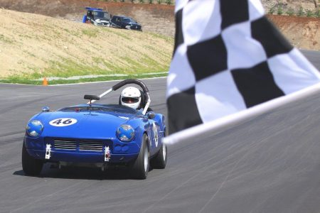 The VRCBC's Phil Pidcock accelerates his '65 Triumph Spitfire across the finish line at the Vancouver Island Motorsport Circuit's Grand Opening. - Paul Bonner photo