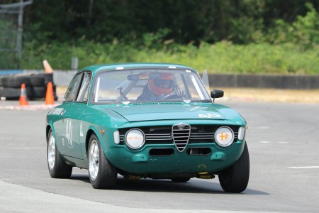 Roger van der Marel exiting Turn 9 in his beautiful 1967 Alfa Romeo GTV. - Brent Martin photo