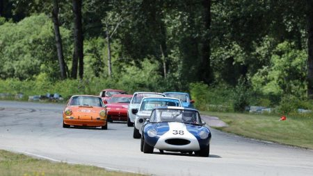 Gunter Pichler (1964 Jaguar E-Type) leads Ian Thomas (1970 BMW 2002), Peter Valkenburg (1969 Porsche 911), Ian Wood (1969 Volvo 142S) and the rest into Turn 2. - Brent Martin photo