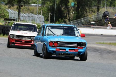 Two Datsun 510's re-create the great battles of the past. VRCBC Vice President Paul Haym in his 1969 model is shown here leading Ian Mackie in his 1970 version. - Brent Martin photo